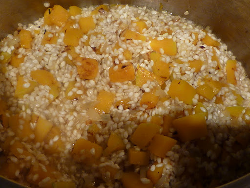 Add rice to the pot with the squash and onion.