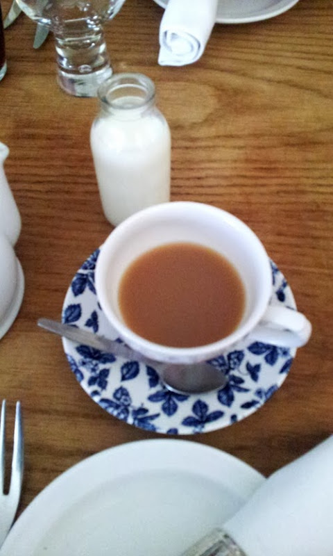 Tea with tiny milk bottle