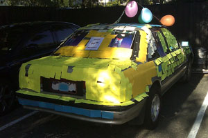 A car almost entirely covered in sticky notes