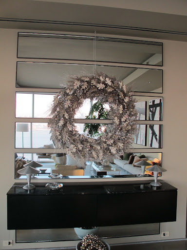 I suspended a gilded wreath from the ceiling in my entryway to welcome guests as they arrive.