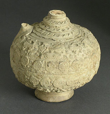 Bottle | Origin: Syria | Period: Early Medieval or Late Medieval | Collection: The Madina Collection of Islamic Art, gift of Camilla Chandler Frost (M.2002.1.90) | Type: Ceramic; Vessel, Earthenware, molded and incised with applied neck, foot, and handle, Height: 9 1/2 in. (24.13 cm)