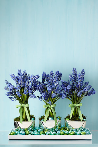 I love the idea of using blue in a floral centerpiece, especially muscari for spring. It's unexpected and looks beautiful and modern. I used chic silver appetizer bowls as containers and grouped them in a tray.  Naturally, I filled the tray with foil covered candy.