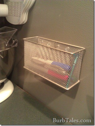Cluttered magnetic pen basket