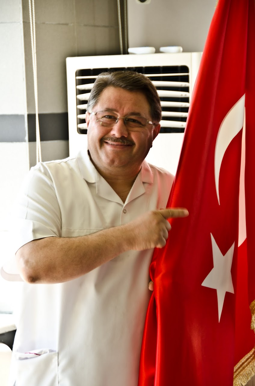 Nadir Gulluoglu with Turkish flag