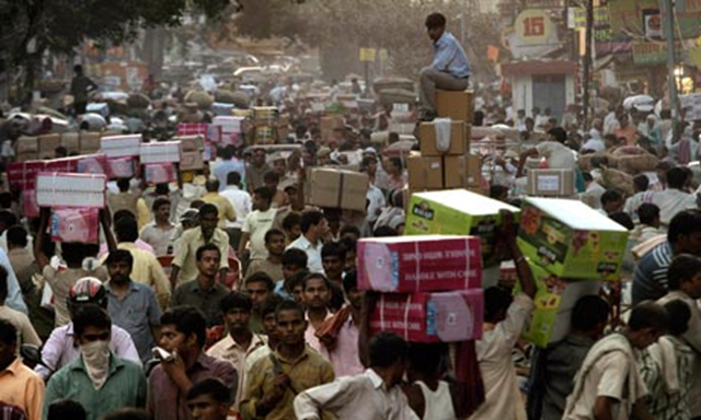 The UN has warned world population could reach 15 billion by 2100, adding pressure to crowded cities such as New Delhi. Manish Swarup / AP