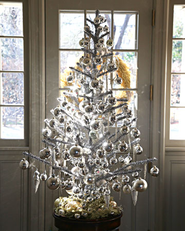 I love that Martha collects and decorates her vintage trees.  This silver tree sits in her entrance at Bedford.(marthastewart.com)