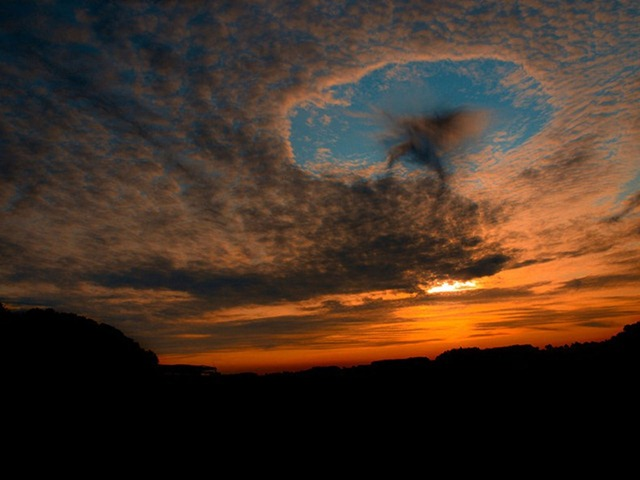punch-hole-clouds-2