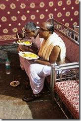 The priests eat after doing their thing
