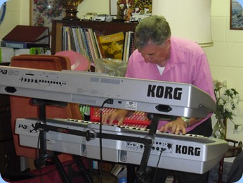 John Bercich in full flght on his two Korg keyboards. Actually, John was using Ken Mahy's Pa80.
