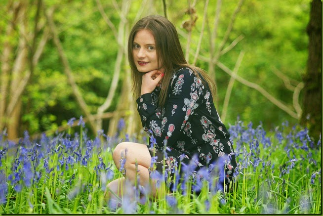 kneeling in bluebells