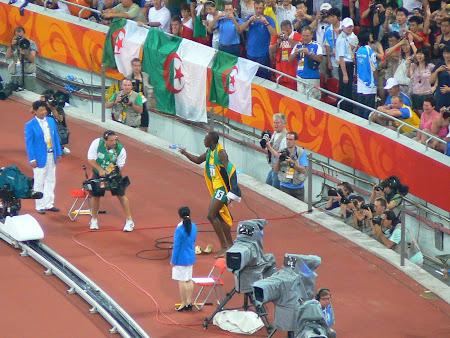 Usain Bolt celebrates the new world record
