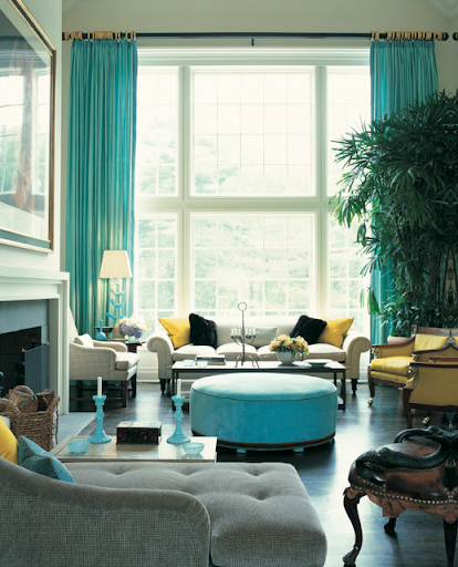 In the same way, this enormous plant brings life and contrast to a teal and yellow palette. (www.thedecorista.com)