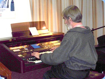 Richard playing the Club's Technics GA3 organ