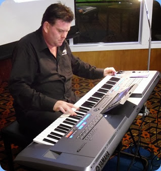 Our guest artist, Chris Larking, playing (superbly) the very latest Yamaha Tyros 5 (76 note version) keyboard. Photo courtesy of Gordon Sutherland