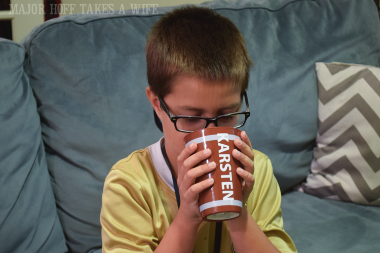 Personalized cups make the party more fun. Looking for a fun party for your teenage boy? Why not throw a Football video game party? Easy ideas for how to entertain kiddos during the Big Game. Features DiGiorno pizza, personalized football cups, free printable lanyards, and an incredible recipe for football shaped ice cream sandwiches! #GameTimeMVP #CollectiveBias #ad
