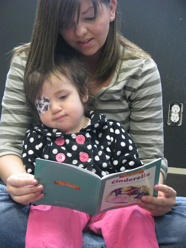 Ashley Perry, coordinator of the Drury University Children's Vision Center, reads a book to Sophia Ponce, 2. (Photo: Jennifer Moore)
