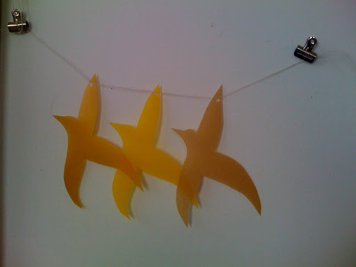 To test out the vellum bird garland, Jen hung it on the wall.