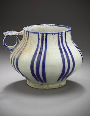 Tankard Iran Tankard, 12th or 13th century Ceramic; Vessel, Fritware, underglaze painted, 7 1/8 x 5 in. (18.10 x 12.70 cm) The Nasli M. Heeramaneck Collection, gift of Joan Palevsky (M.73.5.270) Art of the Middle East: Islamic Department.