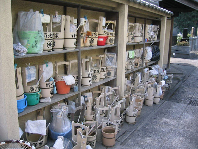 Water buckets for cleaning families&#039; haka (family graves)