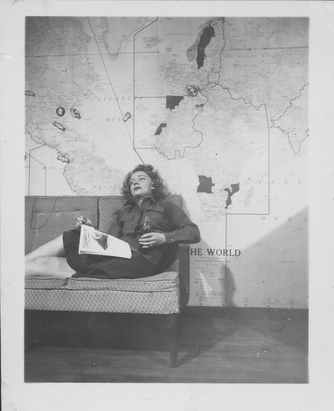 Unidentified Women's Army Corps (WACS) servicewoman takes a break on the sofa. Circa 1945.