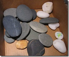 smooth black and grey pebbles from beach