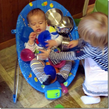 Elaine shares her toy dishes with Nolan