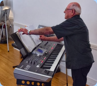 Laurie Conder playing his Roland G-70