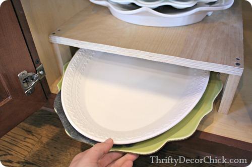 DIY shelf inside cabinet