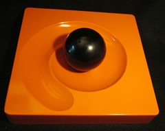 Orange Spyros ashtray with black ball by Eleonore Peduzzi Riva for Artemide (1969)