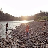 Photograph 1: Children playing in the clear Anap River in front of