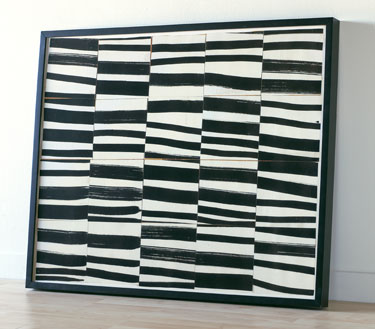 This is a reproduction of Ellsworth Kelly's 'Brushstrokes Cut into Twenty Squares and Arranged by Chance.' A large and bold work of art is a smart way to punctuate a neutral space.