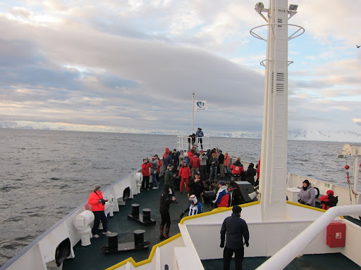 Party on the bow as we cross the Antarctic Circle.