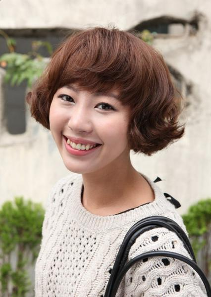 A cute Korean girl with sleek short bob haircut