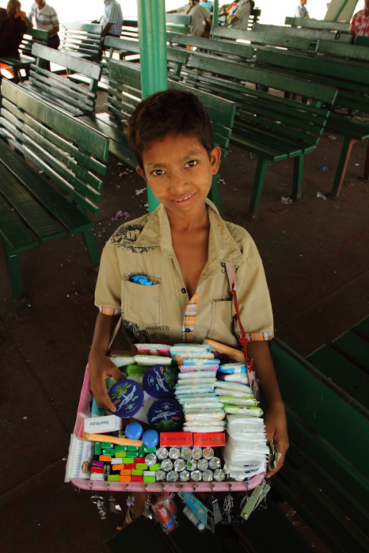 A Burmese Kid selling fast moving items on the Yangon-Dalla Ferry