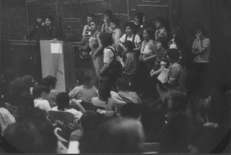 Plenary session at First National Lesbian Conference, Haines Hall, UCLA. Dozens of women line up at the open-mike to speak durring multi-hour plenaries to develop a national lesbian agenda together. April 14-15, 1973.