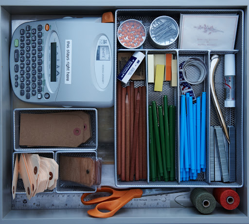 Martha's office supply drawer in her kitchen stays organized with metal drawer dividers.  Don't even think about removing the label maker.