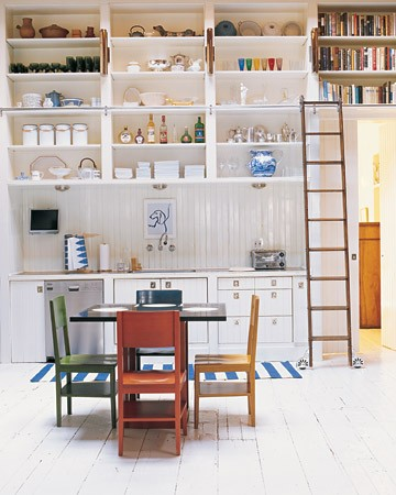 This fun and bright kitchen is actually our Decorating Editor Rebecca's house. We love her inventive use of the rolling ladder. No more standing on counters to reach for tableware. (September 2008)