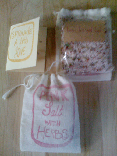 These stamped muslin-bag favors were filled with herbed pink salt.