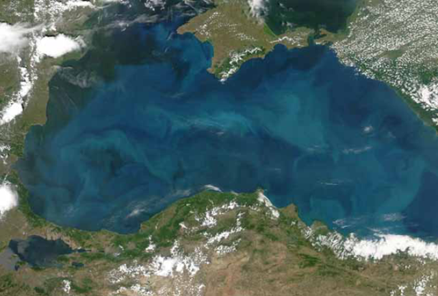 Phytoplankton blooms in the Black Sea, after floods on the Danube River swept over broad stretches of farmland, 20 June 2006. NASA image courtesy of Jeff Schmaltz / MODIS Land Rapid Response Team at NASA GSFC
