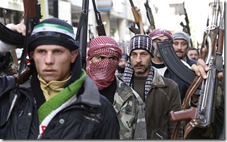 Syrian rebels march in a show of strength during a demonstration in Idlib, Syria, Friday, Feb. 10, 2012. (AP Photo)