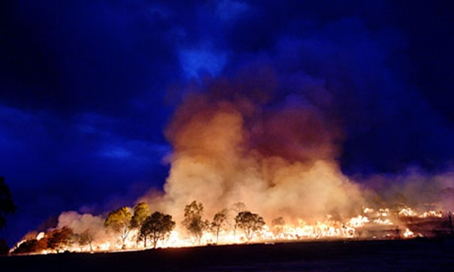 Bushfire at Grampians national park, Victoria, Australia. Extreme weather can lead to more severe and frequent disasters. Global warming has increased five-fold the probabilities that Australians will bake in record hot summers, according to research from the University of Melbourne. Photo: Jason Edwards / Newspix / Rex Feat