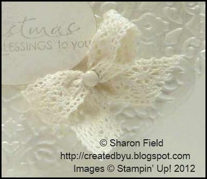 use pliers to open the legs of the brad and insert lace
