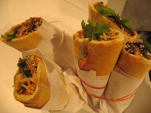 From Baogette, we tasted a Korean-inflected banh mi sandwich that featured beef, kim chi, cilantro, sesame seeds, cucumber, and plenty of spicy and savory sauces on a crusty baguette.