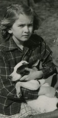 This is Martha as a little girl with Shiner, her very first dog.