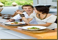 2998393-a-young-couple-on-vacation-eating-lunch-at-a-relaxed-outdoor-restaurant-1
