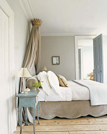 I love the bedskirt silhouette in this Swedish style bedroom. And who wouldn't love to sleep under a royal crown?