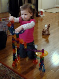 Playing with the marble run. (February)