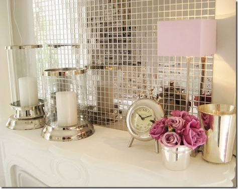 romantic-mantel-fireplace-silver-mosaic-tiles-pink-flowers-hurricanes1