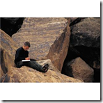 Writer on rocks