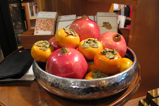 These persimmons and pomegranates would make a pretty centerpiece.